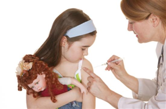 nurse immunizing girl