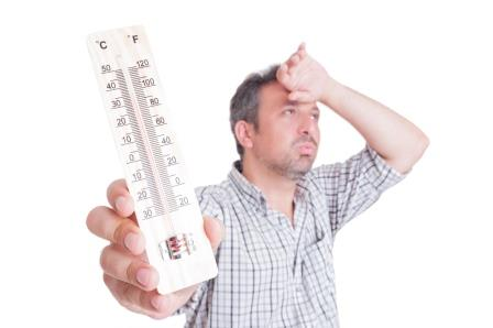 photo of man holding thermometer
